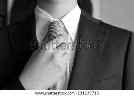 Detail of businessman with hangman's noose instead of tie symbolizing economic problems - stock photo