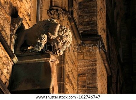 Detail of Canadian Parliament building in Ottawa. Above the entrance the limestone sculpture of a buffalo. - stock photo
