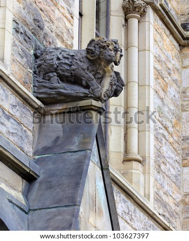 Detail of Canadian Parliament building in Ottawa. Above the entrance the limestone sculpture of a Bighorn Sheep - stock photo