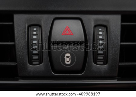 Detail of car interior dashboard with emergency button and distance alert - stock photo