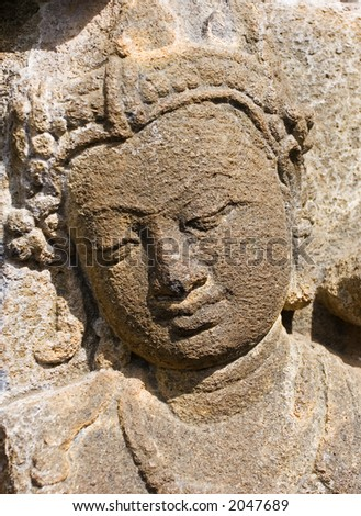 Detail of carved relief at Borobudur on Java, Indonesia. - stock photo