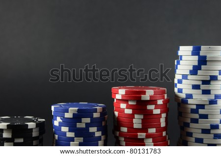 Detail of casino gambling chips over black background - stock photo