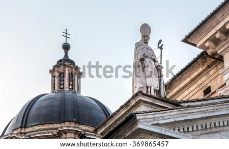 detail of Cathedral facade in Urbino, Italy. The historic center of Urbino was declared a Unesco World Heritage site and represents the zenith of Renaissance architecture. - stock photo