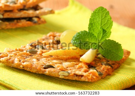 detail of cereal snack with crispy bread and apple - stock photo