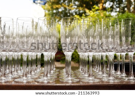 Detail of Champagne Glasses on a Plate - stock photo