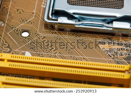 Detail of circuit paths and solderings on a computer mainboard - stock photo