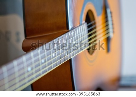 Detail of Classic Brown Guitar with Shallow Depth of Field - stock photo