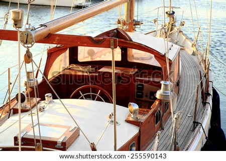 detail of classic old wooden sailing boat in sunlight - stock photo