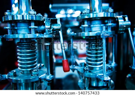 detail of CNC machinery, blue tone. - stock photo