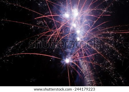 Detail of colorful fireworks explosions in the night sky - stock photo