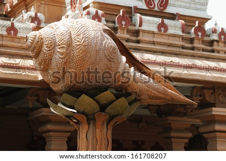 Detail of conch shell sculpture at a temple, Chhatarpur Temple, New Delhi, India - stock photo