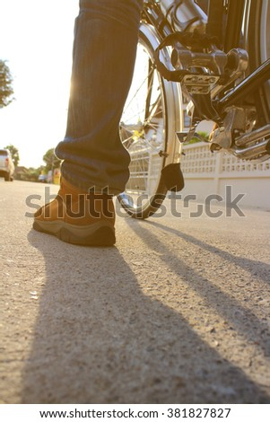 Detail of cyclist men feet riding road bike on the village - stock photo