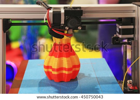 detail of 3d printer printing a plastic piece - stock photo