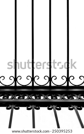 Detail of decorative wrought iron fence in black and white graphic treatment, vertical; in a church, Majorca, Balearic islands, Spain. - stock photo