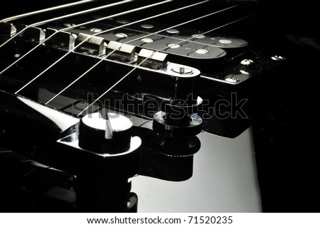 detail of electric guitar - stock photo