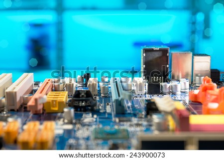 Detail of electronic board in hardware repair shop, shallow DOF, space for your text - stock photo