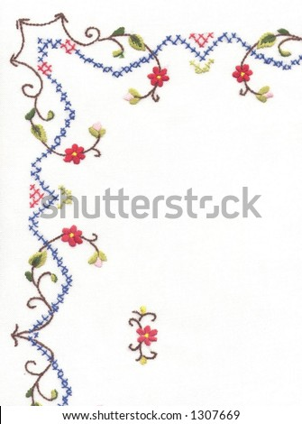Detail of embroidered table cloth - stock photo