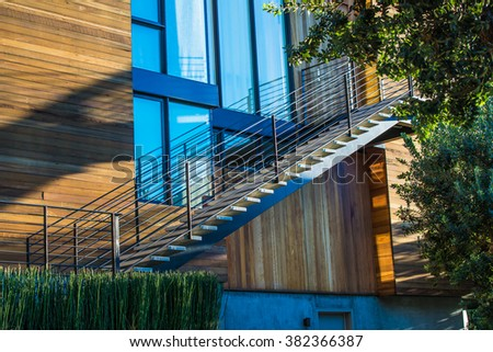 Detail of exterior stair beside modern house - stock photo