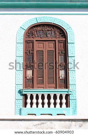 Detail of facade from vintage colonial building in Santiago de Cuba, Cuba - stock photo