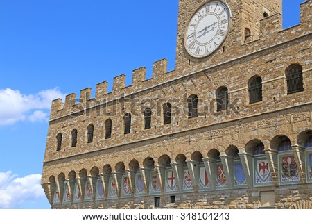 Detail of Facade of Old Palace called Palazzo Vecchio in Florence Italy - stock photo