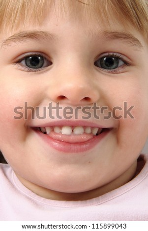 detail of face of small girl - stock photo