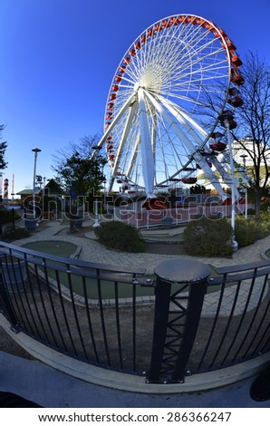 Detail of ferris wheel and blue sky in amusement park - stock photo