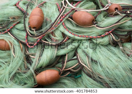 Detail of fishing nets piled up - stock photo