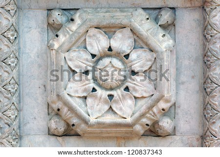 Detail of Floral Stonework and Tiles - stock photo