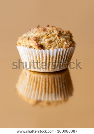 Detail of gluten free muffin with nuts on golden background - stock photo