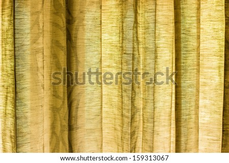 detail of green curtain as background - stock photo