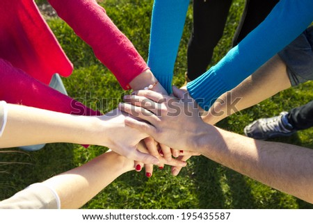 Detail of Group of friends pile up hands as unity oath - stock photo