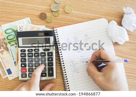 Detail of hands making financial balance. - stock photo