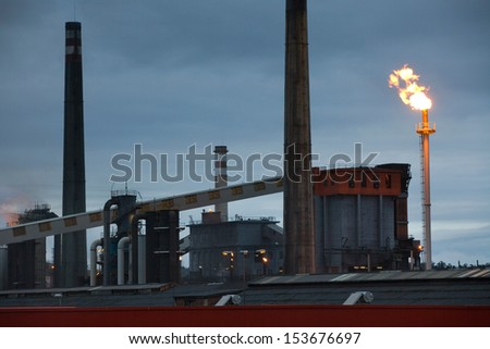 Detail of heavy industry at dawn in Asturias, North Spain. Smokestacks in factory at dawn. - stock photo
