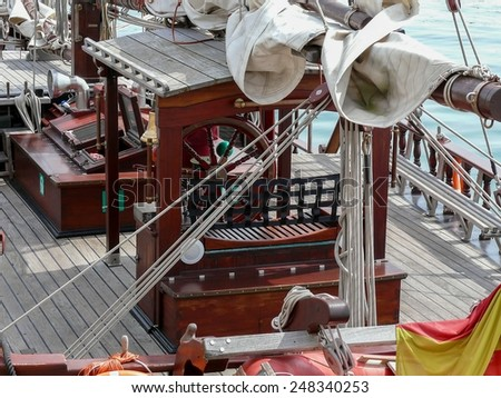 Detail of helm wheel and miscellaneous equipment of a shooner - stock photo