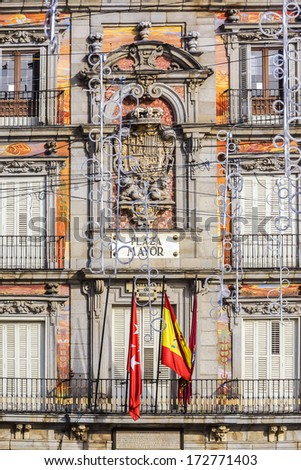 Detail of Historic tenement house facade Casa de la Panaderia decorated before Christmas. Plaza Mayor, Madrid, Spain. - stock photo