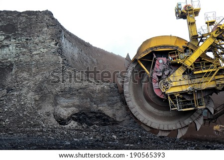 detail of huge coal excavator mining wheel - stock photo