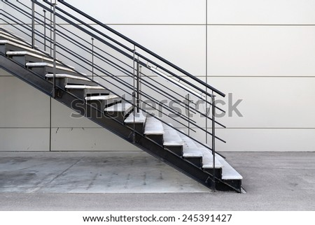 detail of industrial iron stairs in exterior - stock photo