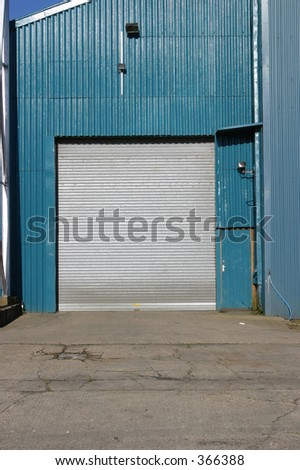 Detail of industrial storage unit and roller shutter door - stock photo