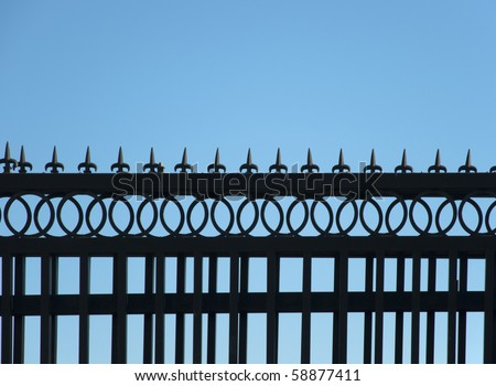 Detail of iron fence against the sky - stock photo