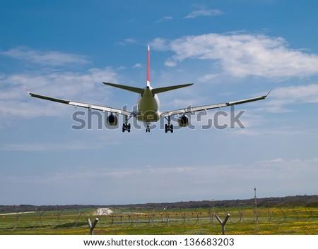 detail of landing airplane - back view - stock photo