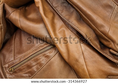 Detail of light brown leather clothing with a distinctive color and texture - stock photo
