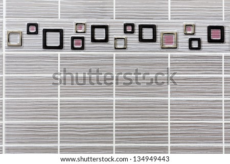 detail of little rectangular tiles with a frame consisting of square shapes - stock photo