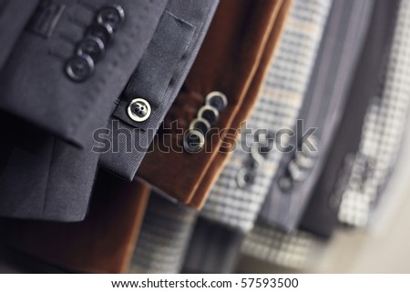 Detail of men's jackets' line in a shop, DOF - stock photo