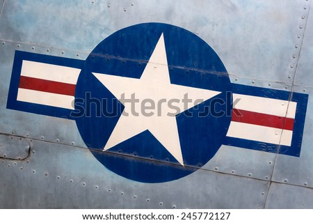 Detail of military airplane fuselage with vintage United States Air Force sign.  - stock photo