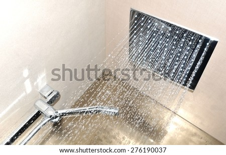 Detail of modern ceiling shower - stock photo