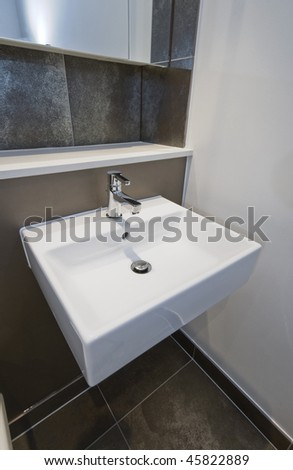 detail of modern square shape hand wash basin - stock photo