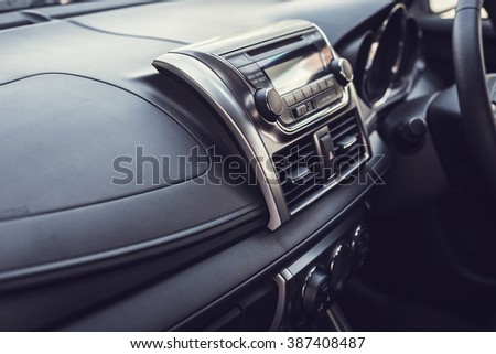 Detail of new modern car interior, Focus on stereo (vintage filter effect) - stock photo