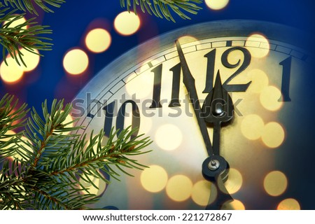 detail of new year clock with lights - stock photo