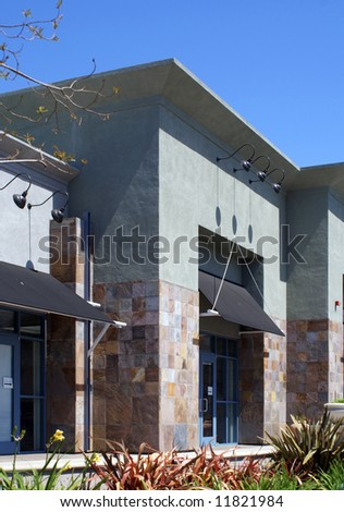 Detail of newly opened shops in a strip mall. - stock photo