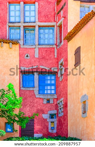 Detail of nice colorful wall with doors and windows, Sardinia, Italy - stock photo